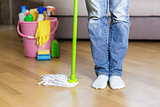 woman holding mop in the home.