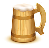 Full wooden beer mug with thick white foam