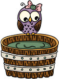 Cute owl with wooden tub for a bath