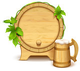 Wooden barrel and full wooden beer mug with thick white foam