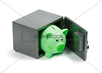 Green ceramic piggy bank in a safe