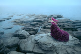 Woman near foggy sea