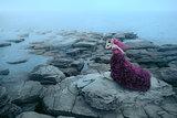 Woman near foggy sea