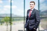Successful businessman posing in office