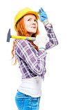 woman in a helmet with a hammer looking up on a white background