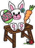 Cute Easter bunny sitting on wooden stool