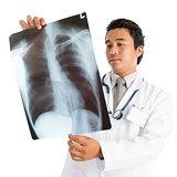 Medical doctor examining xray
