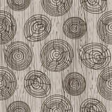 Wooden bark circles beige seamless vector pattern.