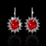 Golden earrings with ruby and diamonds