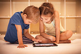 Happy children playing on the tablet