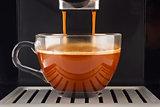 Fresh coffee prepared in the coffee machine.