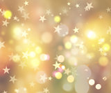 Christmas background of stars and bokeh lights