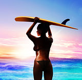 surfer with surfboard at sunrise