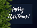 Dark blue christmas background with green branches of Christmas tree and lettering. Vector template.