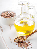 Brown flax seeds and flaxseed oil close up