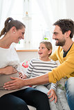 Little family is happy about pregnancy of mother