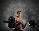 Athletic man training biceps