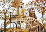 happy tourist woman in Paris, France looking into distance
