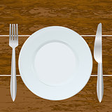 Empty plate, fork and knife on the  wood background