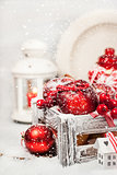 Christmas composition with red apples, balls, cinnamon, snow and