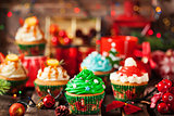Set of different delicious Christmas cupcakes