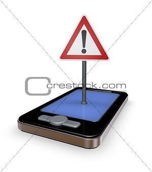 smartphone mit verkehrszeichen achtung