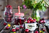 Fresh wet cherry in enamel metal mug