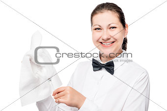 Portrait of bartender waiter with a rag and clean a glass on a w