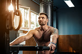 strong man preparing for workout in crossfit gym