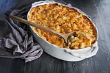 Macaroni and Cheese over Rustic Background