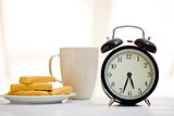 alarm clock and breakfast