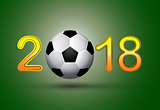 Soccer ball in 2018 digit on green background.