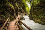 Mountain river and wooden bridge in Vintgar Gorge, Lake Bled