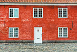 Old red house with white windows and door
