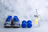 Sport composition with sports equipment and mason jar with lemon