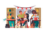 Pupils sit in classroom at desks