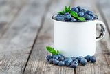 Blueberry in mug background