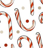 Hand drawn vector abstract Christmas seamless pattern with candy canes isolated on white background.Christmas menu design.Happy New Year and Merry Christmas concept.Wrapping paper.Fabric pattern.