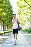 Asian woman talking on mobile phone outdoors