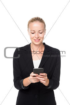 Beautiful young caucasian businesswoman using mobile phone.