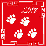 Happy chinese new year 2018 greeting card with traces of dog paws. China new year template for your design. Vector illustration.