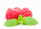 Fresh healthy red raspberries with mint leaf