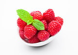 Fresh healthy red raspberries in white bowl