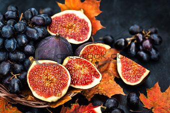 Autumnal fresh ripe figs and purple grape