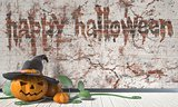Happy Halloween greeting with Jack O Lantern pumpkin and green l