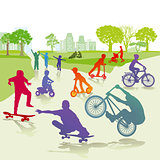 Children with skateboard and bicycle in the park