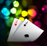 A combination of playing cards for casino. Two aces on bokeh background