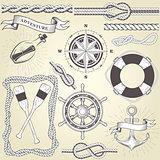 Vintage seafaring elements - steering wheel, oars, rope frame an