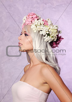 beautiful girl in floral wreath
