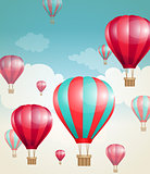 Red air balloons and clouds.